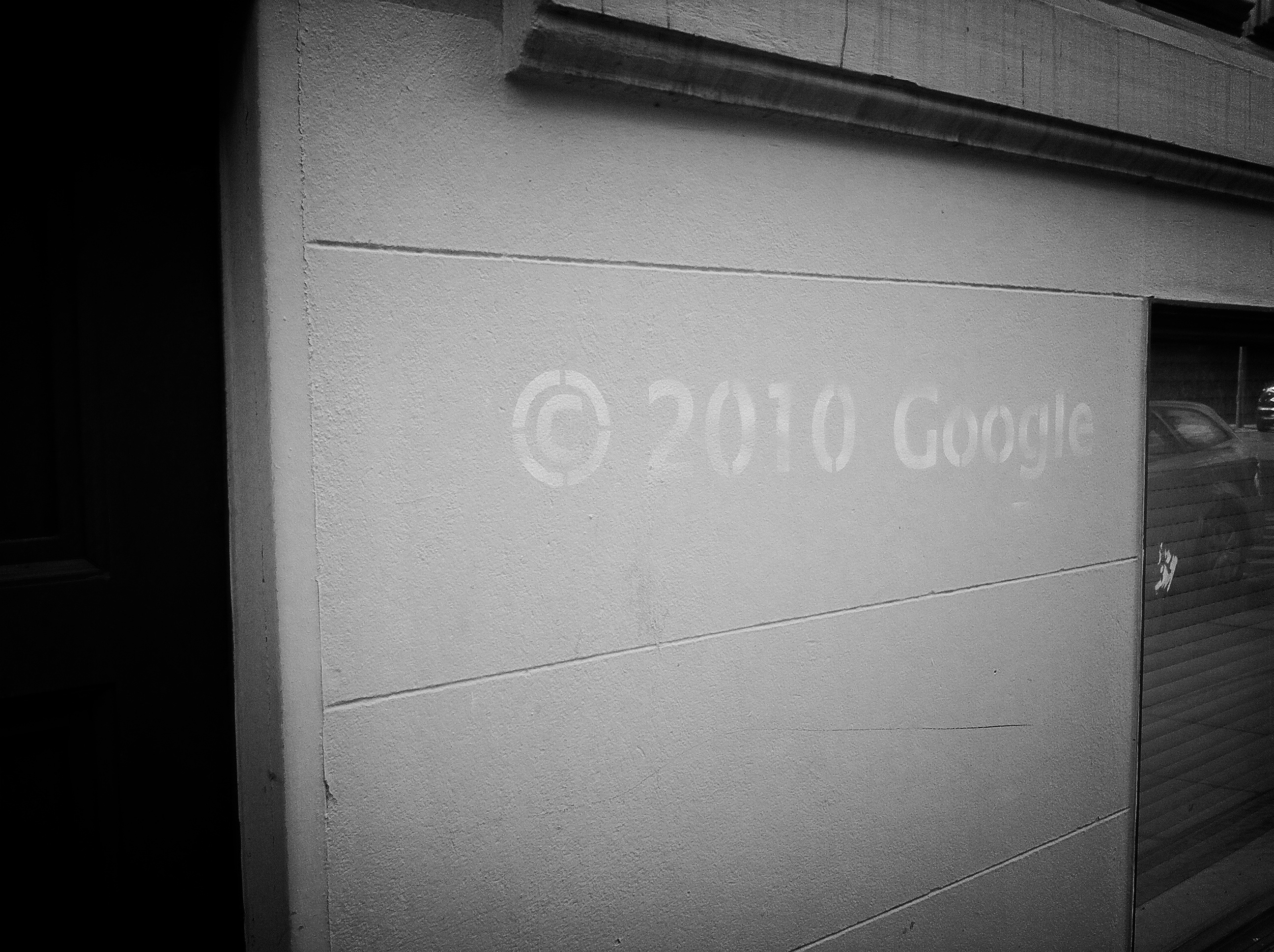 A photograph of an anti-Google graffiti comment.