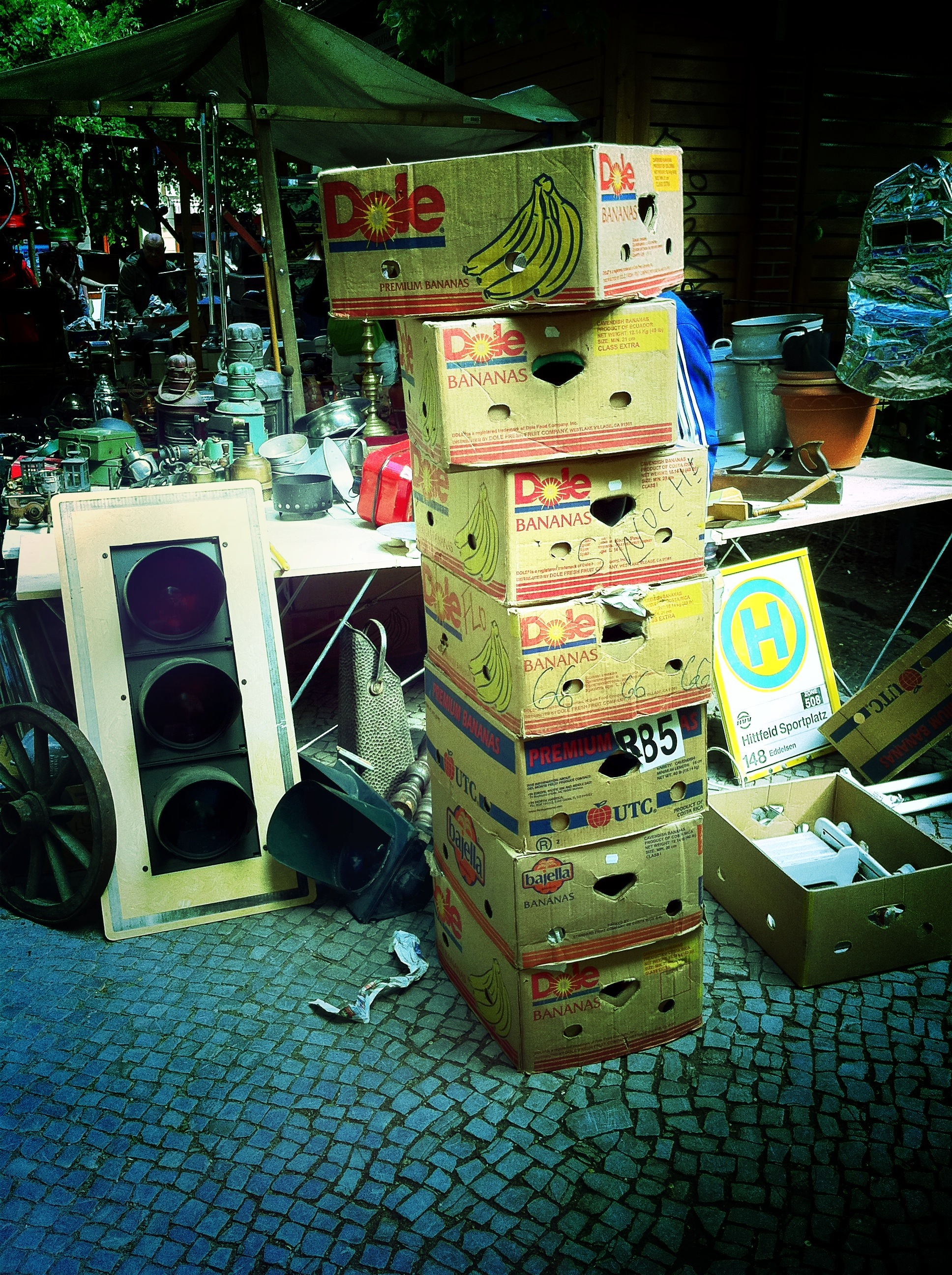 A photograph of several banana boxes being packed up.