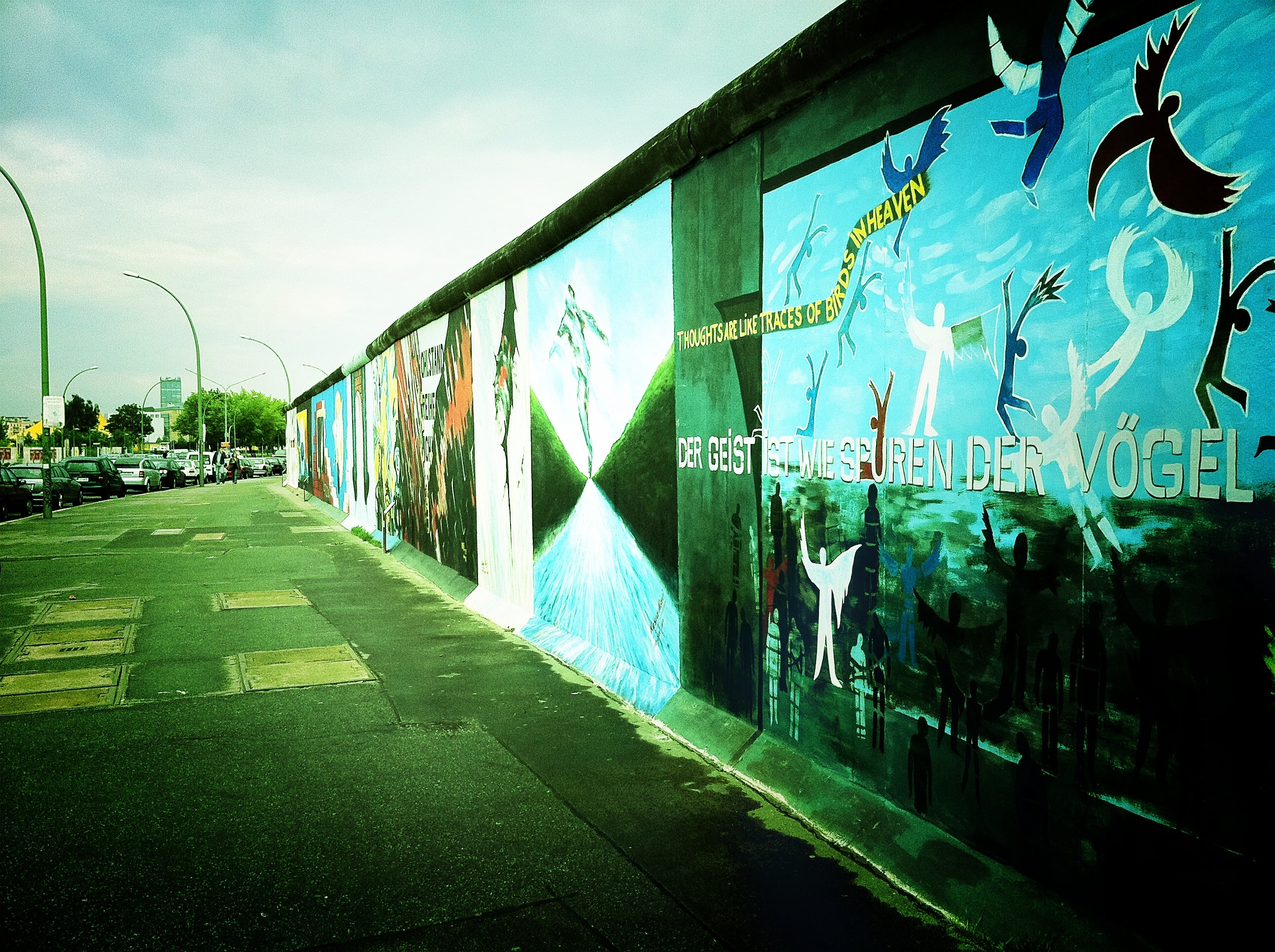 A photograph of graffiti on the western side of the Berlin wall.