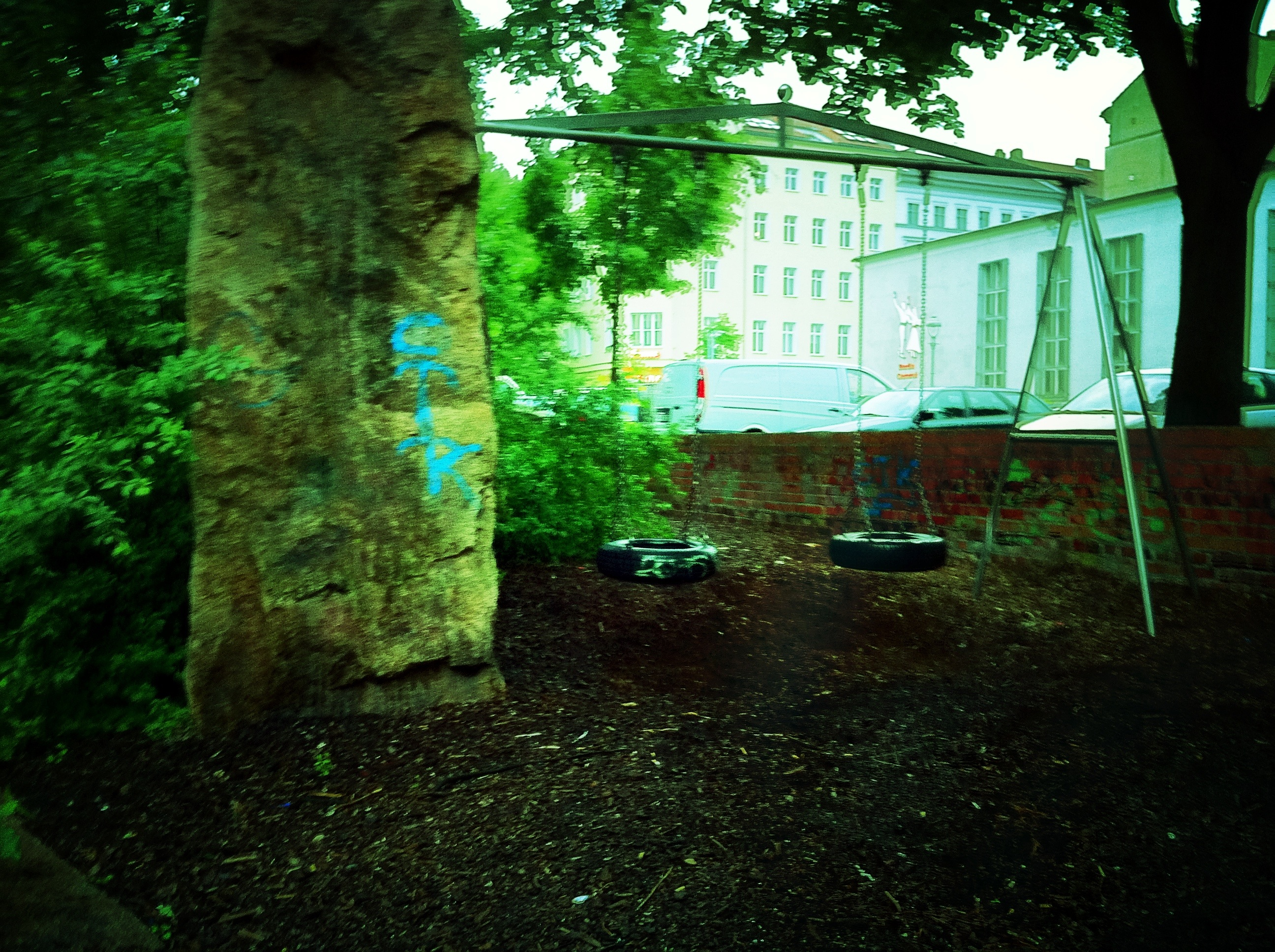 A photograph of a tire swing playground in Berlin.